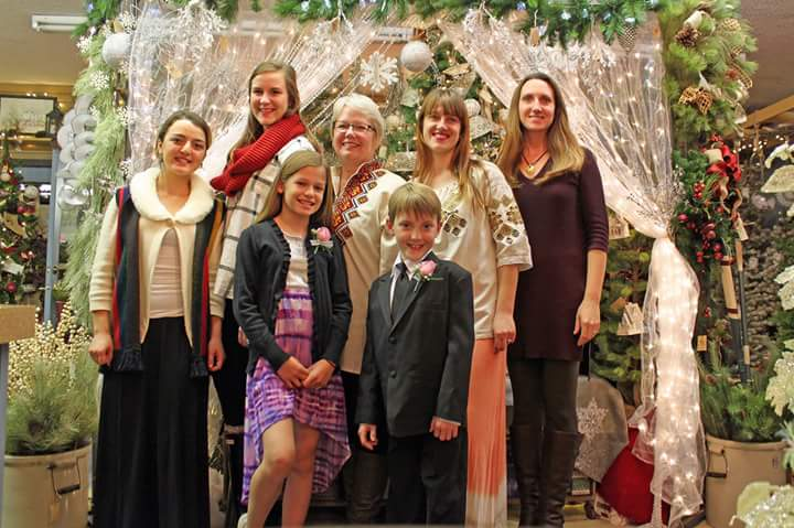 Holiday Open House at Country Gardens Floral and Greenhouse. Pictured are CAEP trainees and host.